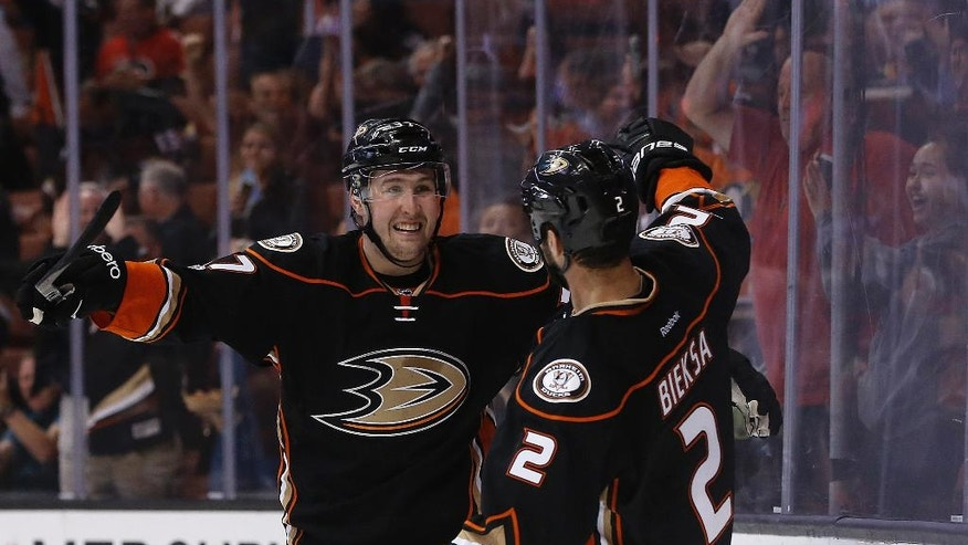 Anaheim Ducks left wing Nick Ritchie, left, congratulates defenseman Kevin Bieksa, who scored against the Calgary Flames during the second period of an NHL hockey game in Anaheim, Calif., Tuesday, April 4, 2017. (AP Photo/Alex Gallardo)