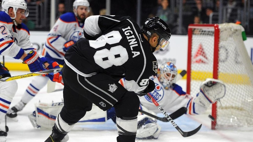 Los Angeles Kings right wing Jarome Iginla (88) has his shot blocked by Edmonton Oilers goalie Cam Talbot during the second period of an NHL hockey game, Tuesday, April 4, 2017, in Los Angeles. (AP Photo/Michael Owen Baker)