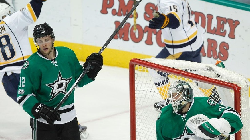 Dallas Stars goalie Antti Niemi (31) and center Radek Faksa (12) react after a goal by Nashville Predators right wing Craig Smith (15) during the first period of an NHL hockey game Thursday, April 6, 2017, in Dallas. (AP Photo/Tim Sharp)