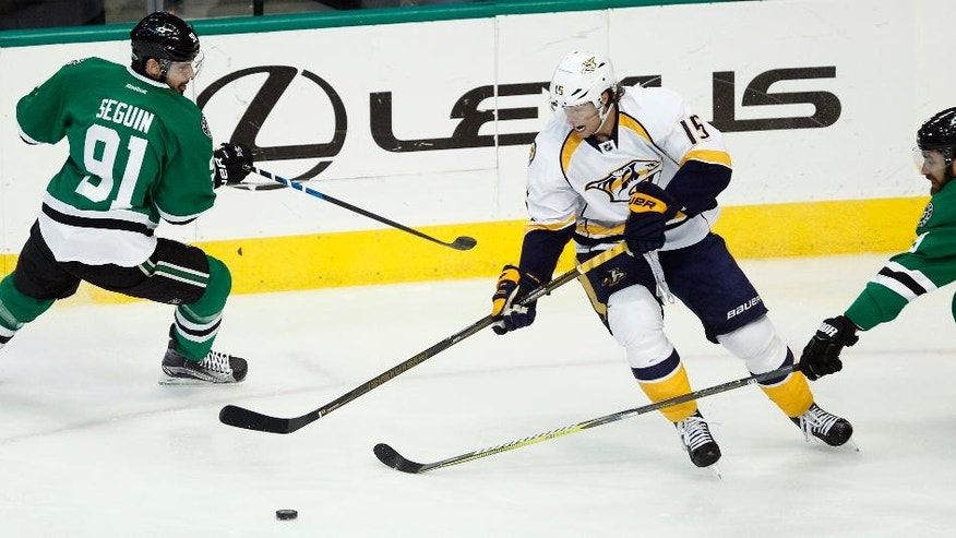 Nashville Predators right wing Craig Smith (15) takes control of the puck as he is pressured by Dallas Stars center Tyler Seguin (91) and defenseman Greg Pateryn during the first period of an NHL hockey game Thursday, April 6, 2017, in Dallas. (AP Photo/Tim Sharp)