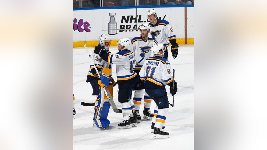 St. Louis Blues goaltender Jake Allen (34) is congratulated by St. Louis Blues left wing Jaden Schwartz (17) and other teammates after the third period of an NHL hockey game, Thursday, April 6, 2017, in Sunrise, Fla. The Blues defeated the Panthers 6-3. (AP Photo/Joel Auerbach)