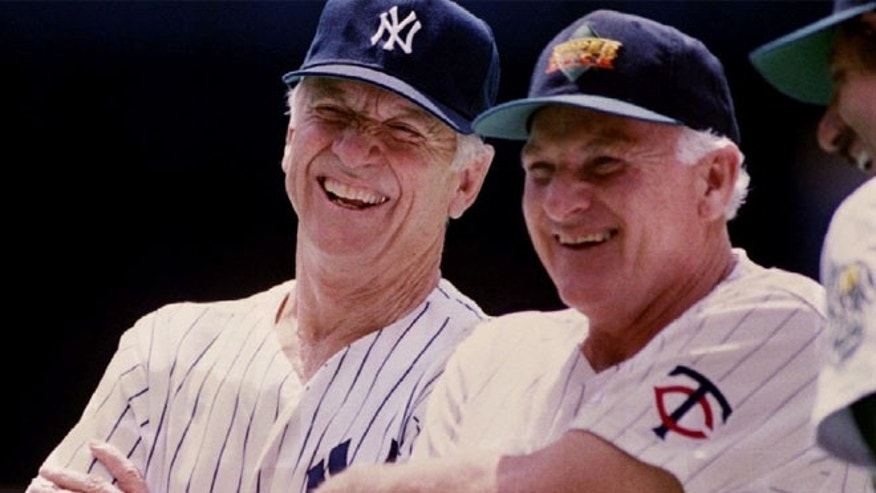 FILE: Former New York Yankees' Mickey Mantle and Minnesota Twins' Harmon Killebrew laugh during the Upper Deck Heroes of Baseball All-Star game in Pittsburgh.