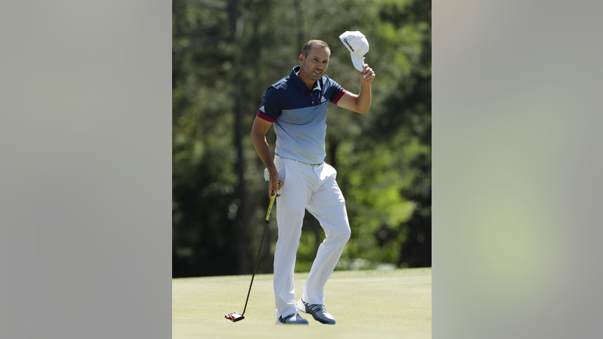 Sergio Garcia, of Spain, tips his hat on the 18th green during the second round of the Masters golf tournament Friday, April 7, 2017, in Augusta, Ga. (AP Photo/David J. Phillip)
