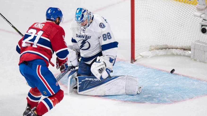 Montreal Canadiens' Dwight King (21) scores past Tampa Bay Lightning goalie Andrei Vasilevskiy during second-period NHL hockey action in Montreal, Friday, April 7, 2017. (Paul Chiasson/The Canadian Press via AP)