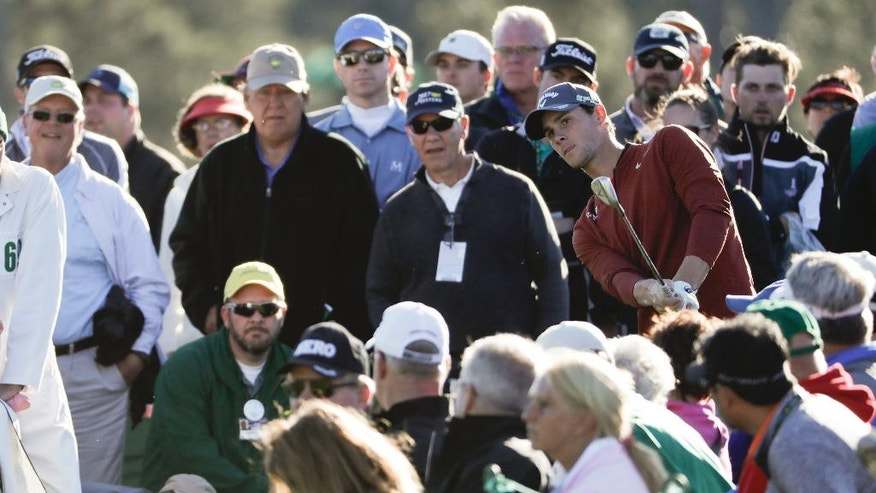Thomas Pieters of Belgium, hits from the crowd on the 18th hole during the second round of the Masters golf tournament Friday, April 7, 2017, in Augusta, Ga. (AP Photo/David Goldman)