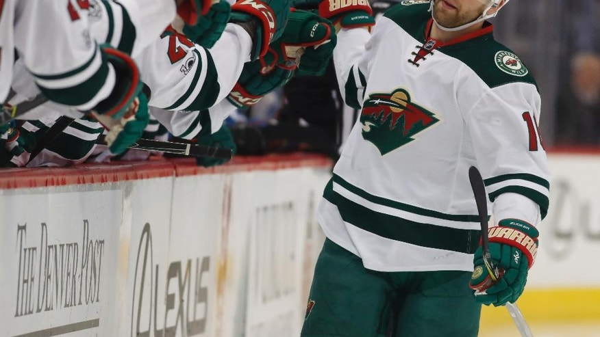 Minnesota Wild left wing Jason Zucker is congratulated as he passes the team box after scoring a goal against the Colorado Avalanche after only 10 seconds elapsed in the first period of an NHL hockey game Thursday, April 6, 2017, in Denver. (AP Photo/David Zalubowski)