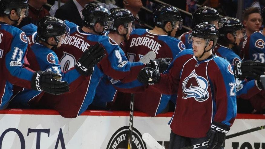 Colorado Avalanche center Tyson Jost is congratulated after scoring a goal against the Minnesota Wild in the second period of an NHL hockey game Thursday, April 6, 2017, in Denver. (AP Photo/David Zalubowski)