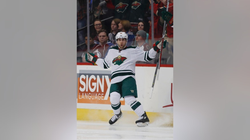 Minnesota Wild left wing Jason Zucker celebrates after scoring a goal against the Colorado Avalanche after only 10 seconds elapsed in the first period of an NHL hockey game Thursday, April 6, 2017, in Denver. (AP Photo/David Zalubowski)