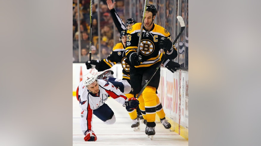 Washington Capitals' Matt Niskanen (2) is knocked to the ice by Boston Bruins' Zdeno Chara during the second period of an NHL hockey game in Boston, Saturday, April 8, 2017. (AP Photo/Winslow Townson)