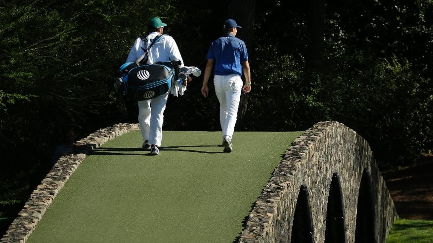 Jordan Spieth walks to the 12th green during the third round of the Masters golf tournament Saturday, April 8, 2017, in Augusta, Ga. (AP Photo/Charlie Riedel)