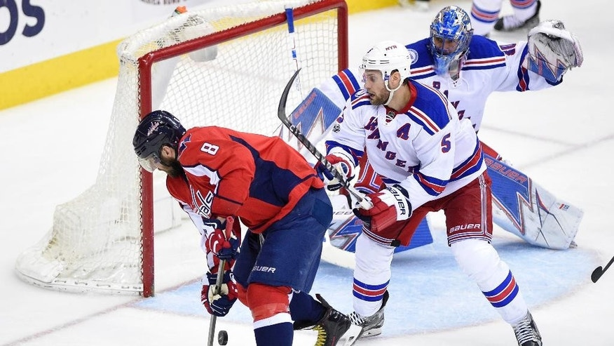 Washington Capitals left wing Alex Ovechkin (8), of Russia, skates with the puck against New York Rangers defenseman Dan Girardi (5) and goalie Henrik Lundqvist, right, of Sweden, during the third period of an NHL hockey game, Wednesday, April 5, 2017, in Washington. The Capitals won 2-0. (AP Photo/Nick Wass)