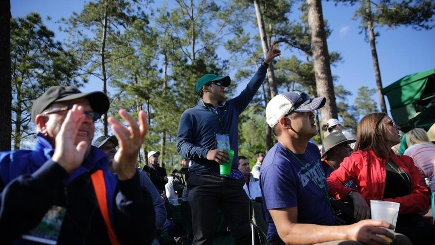 Patrons cheer as Phil Mickelson walks to the 12th hole during the second round of the Masters golf tournament Friday, April 7, 2017, in Augusta, Ga. (AP Photo/David Goldman)