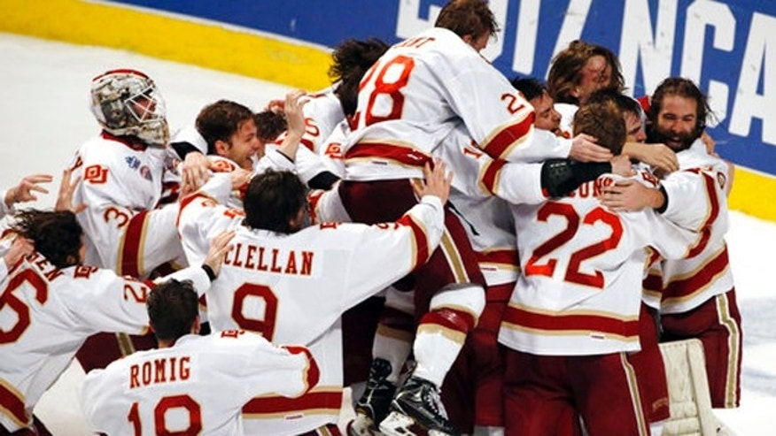 Denver players celebrate their 3-2 win over Minnesota Duluth during an NCAA Frozen Four championship college hockey game, Saturday.