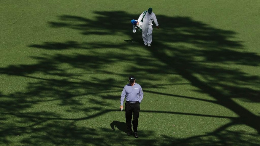 Ernie Els of South Africa, walks up the 15th fairway during the first round for the Masters golf tournament Thursday, April 6, 2017, in Augusta, Ga. (AP Photo/Charlie Riedel)