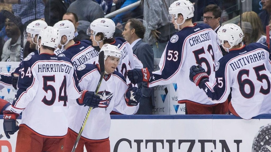 Columbus Blue Jackets' Cam Atkinson, centre left, celebrates after scoring against the Toronto Maple Leafs during second period NHL hockey action in Toronto, on Sunday, April 9, 2017. (Chris Young/The Canadian Press via AP)