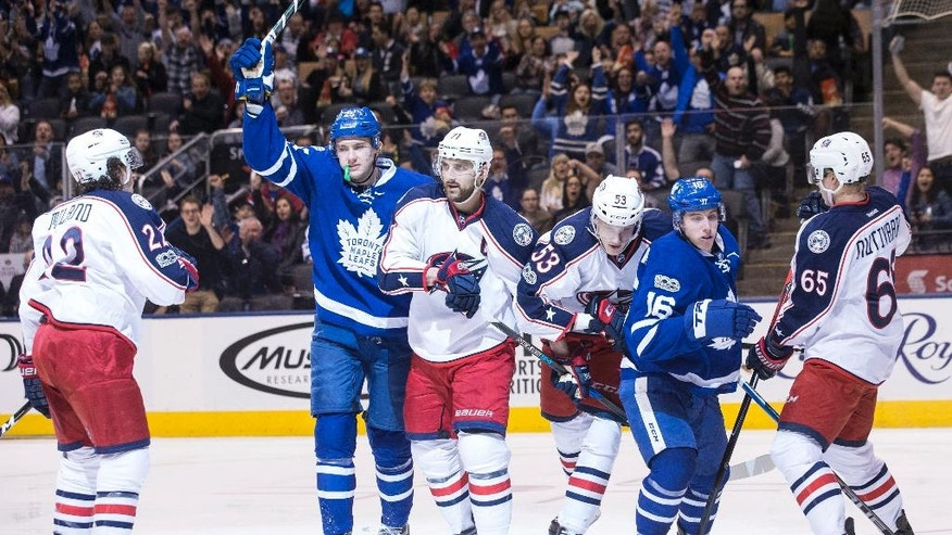 Toronto Maple Leafs' James van Riemsdyk, second left, celebrates his goal against the Columbus Blue Jackets during second period NHL hockey action in Toronto, on Sunday, April 9, 2017. (Chris Young/The Canadian Press via AP)