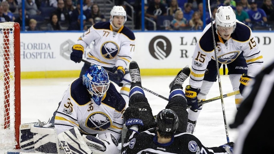 Buffalo Sabres center Jack Eichel (15)knocks down Tampa Bay Lightning left wing Jonathan Drouin (27) on top of goalie Linus Ullmark (35) during the second period of an NHL hockey game, Sunday, April 9, 2017, in Tampa, Fla. (AP Photo/Chris O'Meara)