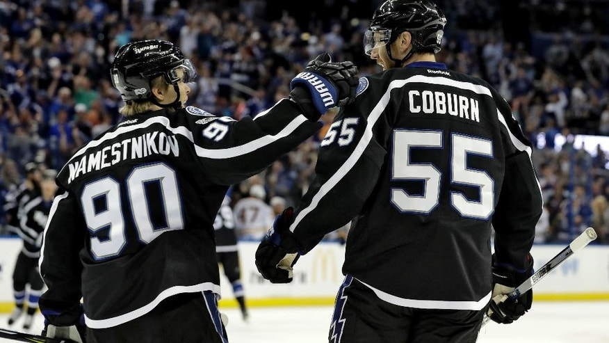 Tampa Bay Lightning defenseman Braydon Coburn (55) celebrates with center Vladislav Namestnikov (90) after scoring against the Buffalo Sabres during the second period of an NHL hockey game, Sunday, April 9, 2017, in Tampa, Fla. (AP Photo/Chris O'Meara)