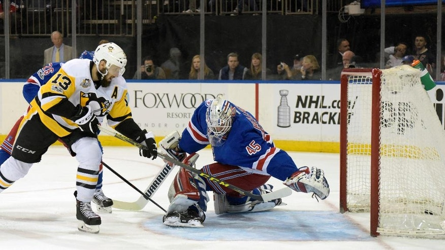 CORRECTS TO MAGNUS HELLBERG- Pittsburgh Penguins center Nick Bonino (13) scores a goal past New York Rangers goalie Magnus Hellberg during the first period of an NHL hockey game Sunday, April 9, 2017, at Madison Square Garden in New York. (AP Photo/Bill Kostroun)