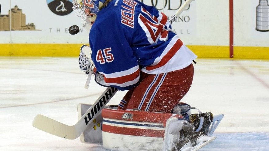 CORRECTS TO MAGNUS HELLBERG- New York Rangers goalie Magnus Hellberg makes a save during the first period of an NHL hockey game against the Pittsburg Penguins Sunday, April 9, 2017, at Madison Square Garden in New York. (AP Photo/Bill Kostroun)