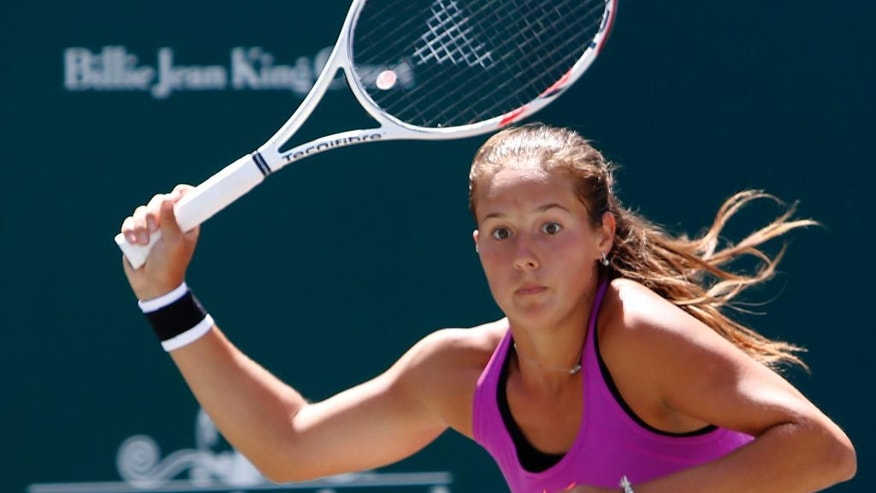 Daria Kasatkina, from Russia, returns a shot to Jelena Ostapenko, from Latvia, during their finals match at the Volvo Car Open in Charleston, S.C., Sunday, April 9, 2017. Kasatkina won 6-3, 6-1.(AP Photo/Mic Smith)