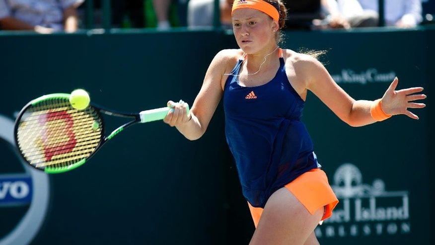Jelena Ostapenko, from Latvia, returns a shot to Daria Kasatkina, from Russia, during their finals match at the Volvo Car Open in Charleston, S.C., Sunday, April 9, 2017. Kasatkina won 6-3, 6-1.(AP Photo/Mic Smith)