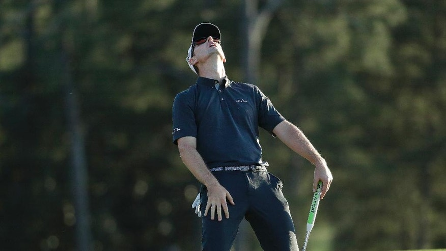 Justin Rose, of England, reacts after missing a birdie putt on the 18th hole during the final round of the Masters golf tournament, Sunday, April 9, 2017, in Augusta, Ga. (AP Photo/Chris Carlson)