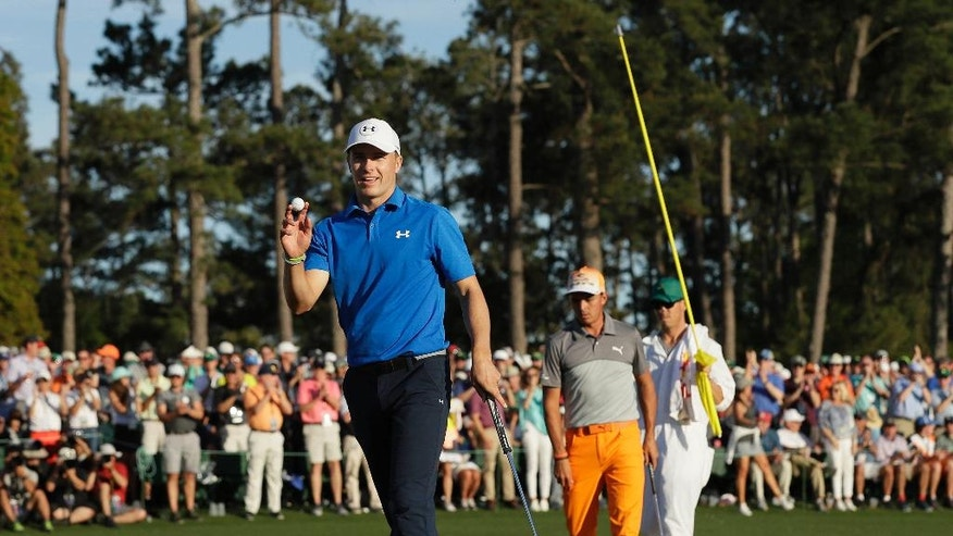 Jordan Spieth reacts after his birdie on the 18th hole during the final round of the Masters golf tournament, Sunday, April 9, 2017, in Augusta, Ga. (AP Photo/David J. Phillip)
