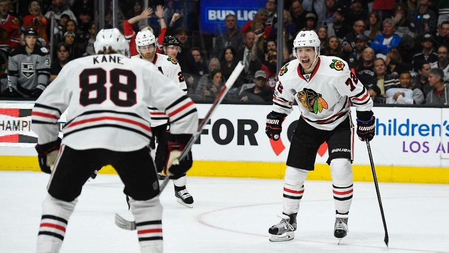 Chicago Blackhawks left wing Artemi Panarin, right, of Russia, celebrates his goal with right wing Patrick Kane during the third period of the team's NHL hockey game against the Los Angeles Kings, Saturday, April 8, 2017, in Los Angeles. The Kings won 3-2 in overtime. (AP Photo/Mark J. Terrill)
