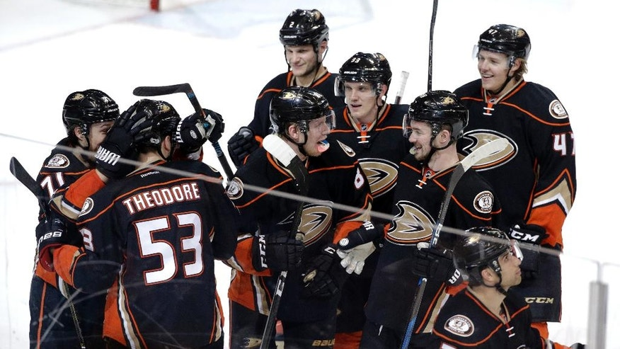Anaheim Ducks players celebrate their team's 4-3 overtime win against the Los Angeles Kings in an NHL hockey game Sunday, April 9, 2017, in Anaheim, Calif. (AP Photo/Jae C. Hong)