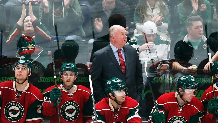 FILE - In this Feb. 18, 2017 file photo Minnesota Wild head coach Bruce Boudreau watches his NHL hockey team play against the Nashville Predators in St. Paul, Minn. Boudreau is back in the playoffs with a third team, the Minnesota Wild in his debut season. For the eighth time in this unique character of a coach's nine postseason appearances, his team has one of the top two records in its conference. (AP Photo/Jim Mone,File)