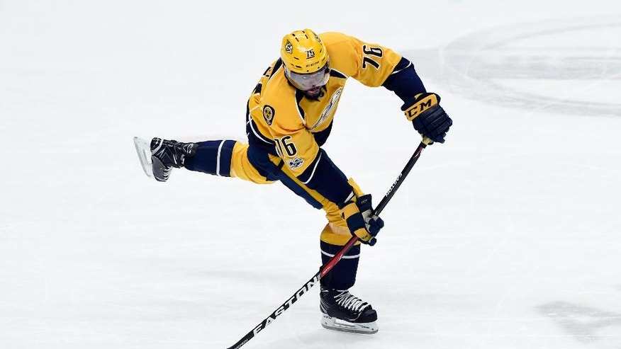 FILe - In this Feb. 26, 2017, file photo, Nashville Predators defenseman P.K. Subban plays against the Edmonton Oilers during the third period of an NHL hockey game, in Nashville, Tenn. The Predators swapped All-Star defensemen last summer hoping Subban could help boost their offense. After his first season, the Predators are among the NHL's best-scoring teams since the All-Star break. Now they hope he helps them go even deeper this postseason.  (AP Photo/Mark Zaleski, File)