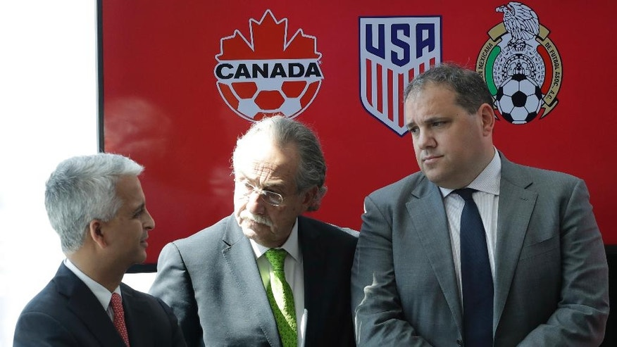 Sunil Gulati, left, President of the United States Soccer Federation, Decio de Maria, center, President of the Mexican Football Federation, and Victor Montagliani, President of the Canadian Soccer Association, hold a news conference, Monday, April 10, 2017, in New York. The three soccer federations announced a bid to co-host the 2026 World Cup. (AP Photo/Mark Lennihan)