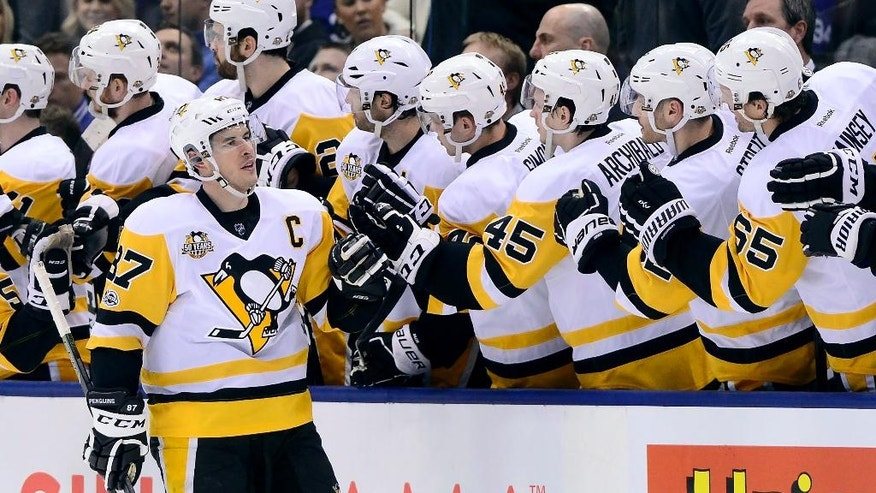 Pittsburgh Penguins centre Sidney Crosby (87) gets congratulations on his goal against the Toronto Maple Leafs during the second period of an NHL hockey game in Toronto on Saturday, April 8, 2017. (Frank Gunn/The Canadian Press via AP)