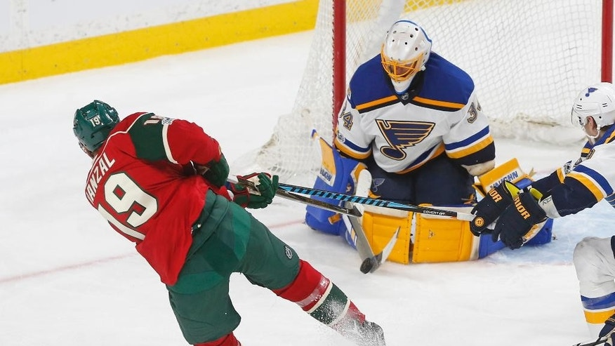 FILE - In this March 7, 2017, file photo, St. Louis Blues goalie Jake Allen stops a shot by Minnesota Wild's Martin Hanzal during the third period of an NHL hockey game Tuesday, March 7, 2017, in St. Paul, Minn. Here comes Minnesota's first-round opponent, none other than the surging St. Louis team coached by former Wild bench boss Mike Yeo. The Blues were ousted in the Western Conference quarterfinals by the Wild two years ago.  (AP Photo/Jim Mone, File)