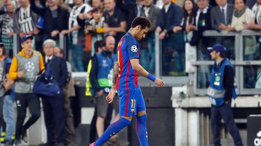 Barcelona's Neymar walks off the pitch at the end of a Champions League, quarterfinal, first-leg soccer match between Juventus and Barcelona, at the Juventus Stadium in Turin, Italy, Tuesday, April 11, 2017. Juventus won 3-0. (AP Photo/Antonio Calanni)