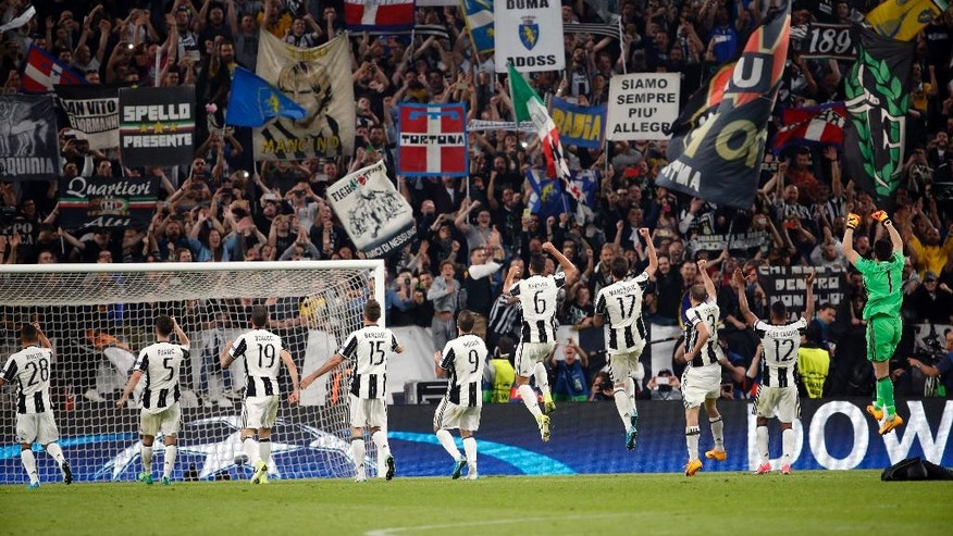 Juventus players celebrate their 3-0 win, at the end of a Champions League, quarterfinal, first-leg soccer match between Juventus and Barcelona, at the Juventus Stadium in Turin, Italy, Tuesday, April 11, 2017. Juventus won 3-0. (AP Photo/Antonio Calanni)