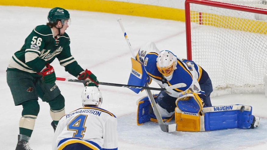 St. Louis Blues goalie Jake Allen, right, has a shot by shot by Minnesota Wild's Erik Haula of Finland deflect off his leg pad during the first period of Game 1 of an NHL hockey first-round playoff series Wednesday, April 12, 2017, in St. Paul, Minn. (AP Photo/Jim Mone)