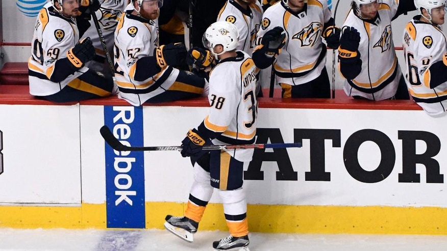 Nashville Predators right wing Viktor Arvidsson (38) celebrates his goal against the Chicago Blackhawks with teammates during the first period in Game 1 of a first-round NHL hockey playoff series Thursday, April 13, 2017, in Chicago. (AP Photo/David Banks)