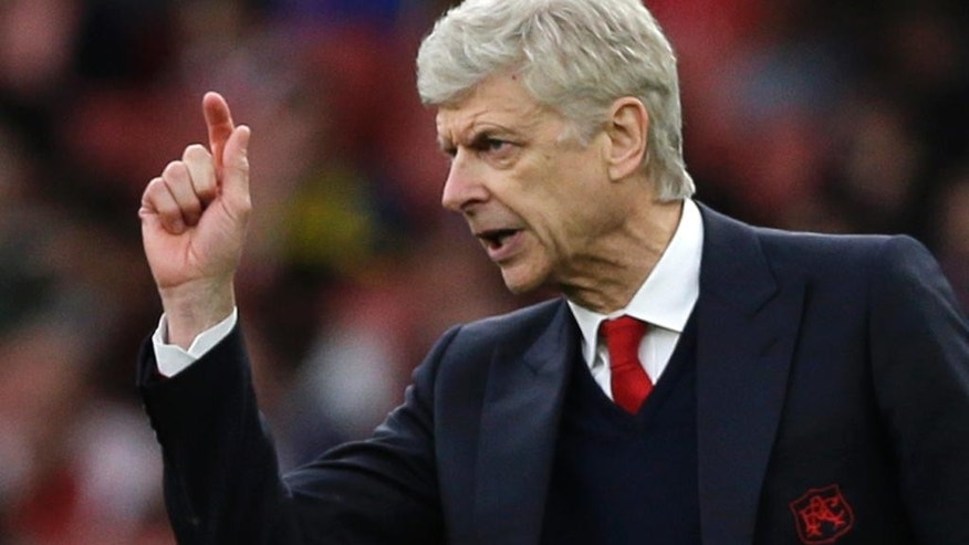 "FILE - In this  Sunday, April 2, 2017 file photo, Arsenal team manager Arsene Wenger gestures during the English Premier League soccer match between Arsenal and Manchester City at the Emirates stadium in London. With Arsenal in danger of failing to qualify for the Champions League for the first time in 21 years, manager Arsene Wenger says his sixth-placed team faces a ""massive"" challenge to finish in the top four of the Premier League, Wenger said Friday April 14, 2017. (AP Photo/Alastair Grant, File)"