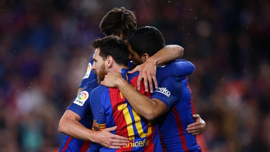 FC Barcelona's Lionel Messi, left, celebrates after scoring during the Spanish La Liga soccer match between FC Barcelona and Real Sociedad at the Camp Nou stadium in Barcelona, Spain, Saturday, April 15, 2017. (AP Photo/Manu Fernandez)
