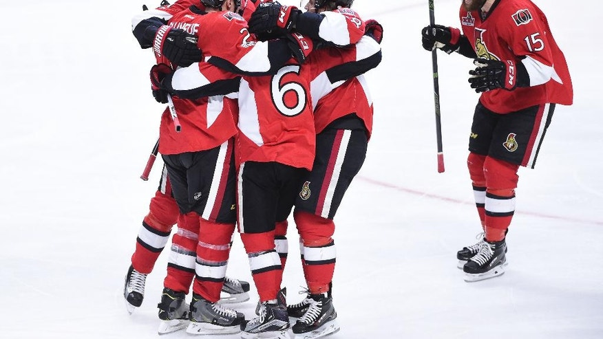 Ottawa Senators celebrate their goal by Ottawa Senators defenseman Chris Wideman (6) during third period of game two NHL Stanley Cup hockey playoff action against the Boston Bruins, in Ottawa, Saturday, April 15, 2017. (Sean Kilpatrick/The Canadian Press via AP)