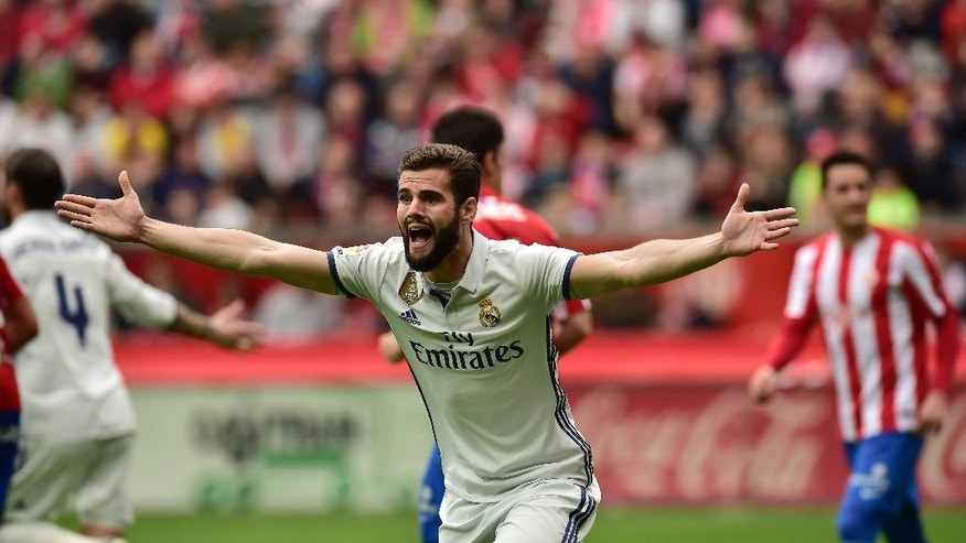 Real Madrid's Nacho Fernandez protests a decision of referee during the Spanish La Liga soccer match between Real Madrid and Sporting de Gijon, at El Molinon stadium in Gijon, northern Spain, Saturday, April 15, 2017. (AP Photo/Alvaro Barrientos)