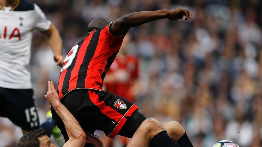 Tottenham Hotspur's Jan Vertonghen and Bournemouth's Benik Afobe, top, challenge for the ball during the English Premier League soccer match between Tottenham Hotspur and Bournemouth at White Hart Lane stadium in London, Saturday, April 15, 2017.(AP Photo/Frank Augstein)