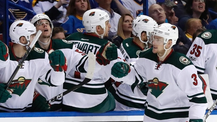 Minnesota Wild's Charlie Coyle (3) is congratulated by teammates after scoring during the second period in Game 3 of an NHL hockey first-round playoff series against the St. Louis Blues Sunday, April 16, 2017, in St. Louis. (AP Photo/Jeff Roberson)