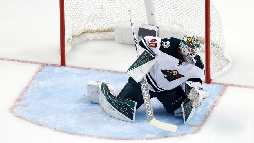 A shot by St. Louis Blues' Colton Parayko sails over the head of Minnesota Wild goalie Devan Dubnyk for a goal during the first period in Game 3 of an NHL hockey first-round playoff series Sunday, April 16, 2017, in St. Louis. (AP Photo/Jeff Roberson)