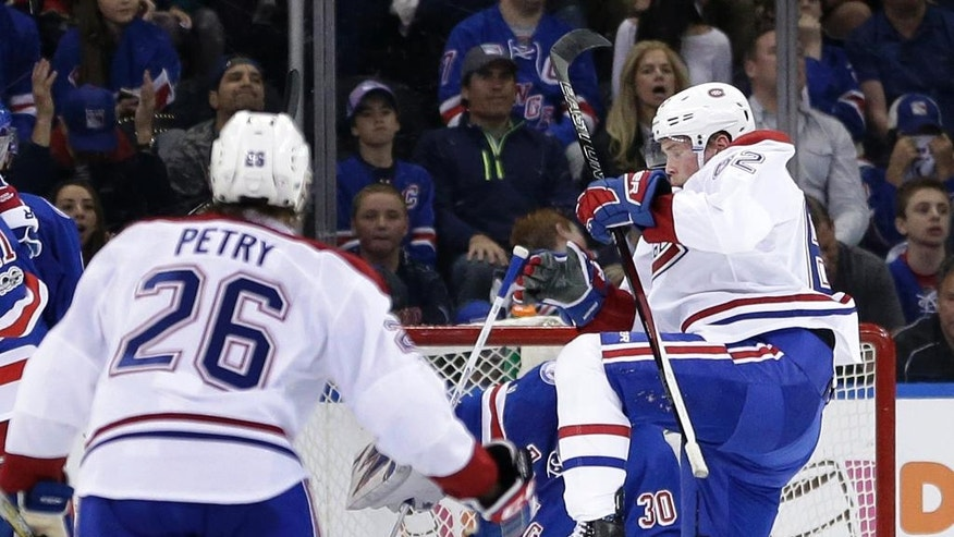 Montreal Canadiens' Artturi Lehkonen, right, reacts after scoring during the second period in Game 3 of an NHL hockey first-round playoff series against the New York Rangers, Sunday, April 16, 2017, in New York. (AP Photo/Seth Wenig)