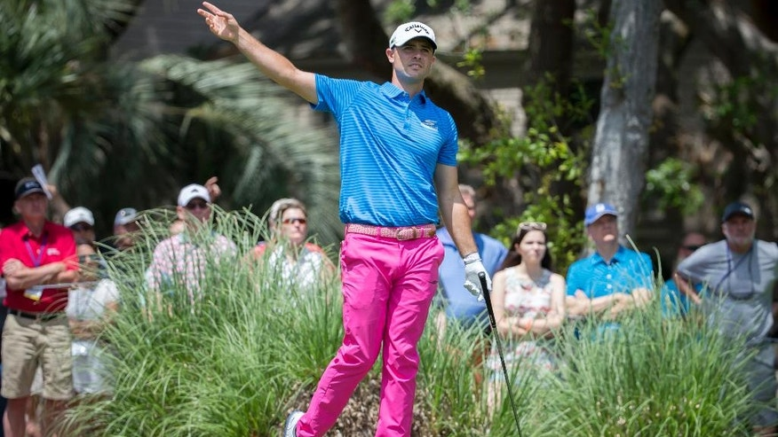 Wesley Bryan warns spectators of a wayward shot from the second tee during the final round of the RBC Heritage golf tournament in Hilton Head Island, S.C., Sunday, April 16, 2017. (AP Photo/Stephen B. Morton)