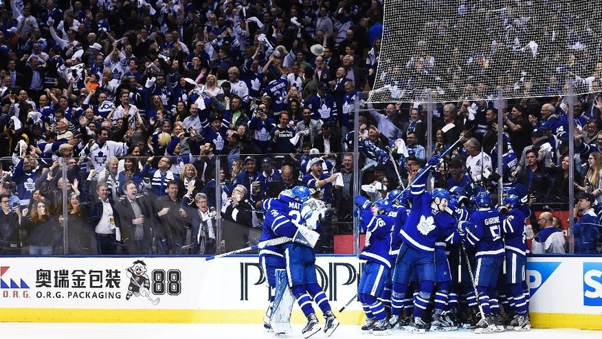 Toronto Maple Leafs players celebrate Tyler Bozak's game-winning goal against the Washington Capitals during overtime in Game 3 of an NHL Stanley Cup first-round playoff series in Toronto on Monday, April 17, 2017. (Nathan Denette/The Canadian Press via AP)