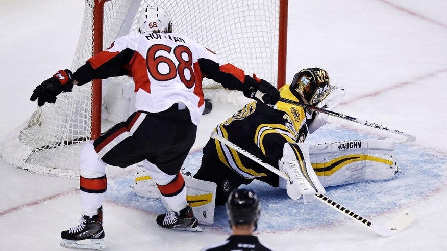 Ottawa Senators left wing Mike Hoffman (68) tips the puck past Boston Bruins goalie Tuukka Rask (40) for a goal as he skates past during the first period in Game 3 of a first-round NHL hockey playoff series in Boston, Monday, April 17, 2017. (AP Photo/Charles Krupa)